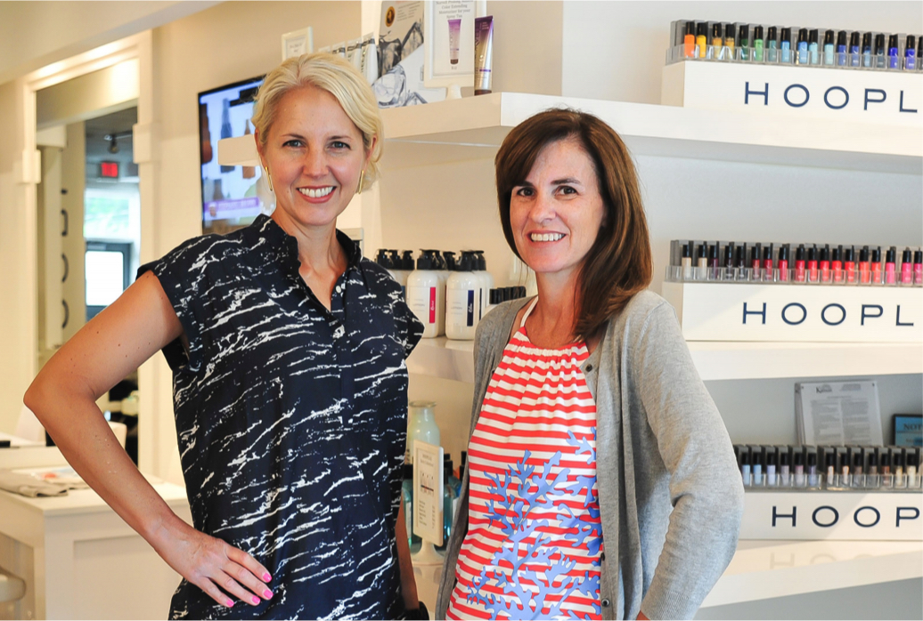The owners of Hoopla in their store