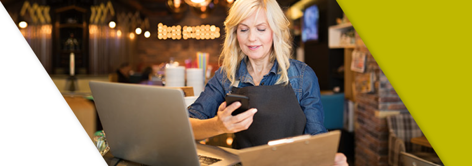 Lead Bank Business Mobile Banking restaurant owner looking at phone