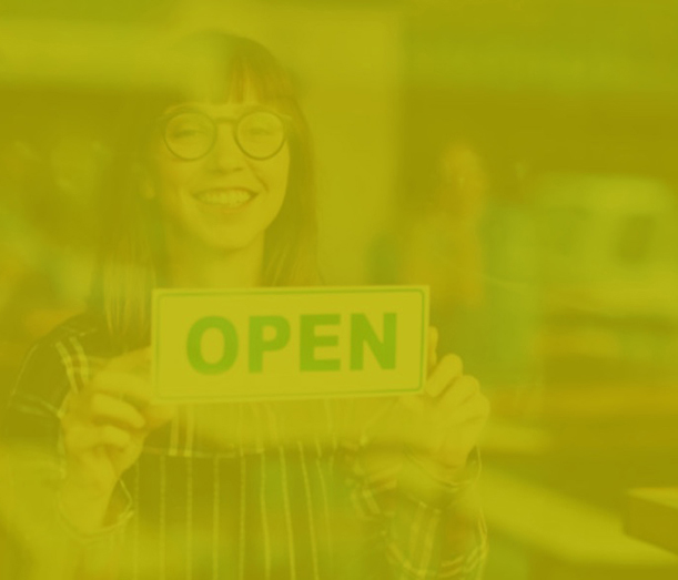 Woman holding open sign with green overlay